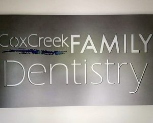 Stencil cut Dentist Office sign with a colored backplate