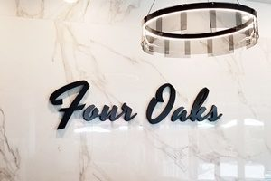 Four Oaks Lobby Sign Washington DC
