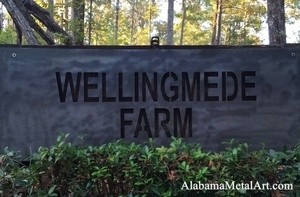 Wellington Farm Sign letters mounted on a stone wall